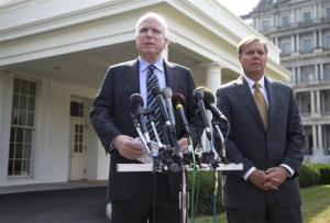John McCain, left, accompanied by Lindsey Graham, speaks with reporters outside the White House.