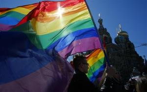 Gay rights activists carry rainbow flags as they march during a May Day rally in St. Petersburg, Russia.