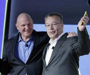 Steve Ballmer and Stephen Elop, president and CEO of Nokia, introduce Nokia's newest smartphone, Wednesday, Sept. 5, 2012 in New York.