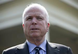 Sen. John McCain speaks with reporters outside the White House Monday.