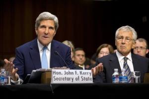 Secretary of State John Kerry, left, with Defense Secretary Chuck Hagel, testifies on Capitol Hill.