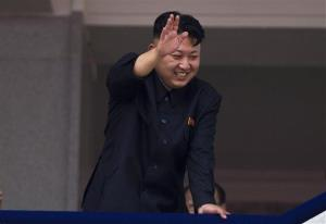 North Korean leader Kim Jong Un waves to Korean War veterans.
