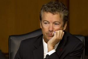 Sen. Rand Paul, R-Ky., listens as Secretary of State John Kerry answers Paul's question on Capitol Hill Tuesday.