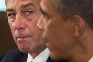 House Speaker John Boehner listens as President Barack Obama speaks to media in the Cabinet Room of the White House in Washington, Tuesday, Sept. 3, 2013.