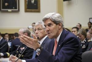 John Kerry, right, accompanied by Defense Secretary Chuck Hagel, center, and Joint Chiefs Chairman Gen. Martin Dempsey, left, testifies on Capitol Hill in Washington, Wednesday, Sept. 4, 2013.