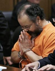 FILE - In this Aug. 1, 2013 file photo, Ariel Castro bows his head in the courtroom during his sentencing sentencing in Cleveland. Castro, 53, now serving a life sentence for the kidnapping and rape, was found hanging in his cell, Tuesday night, Sept. 3, 2013, at the Correctional Reception...
