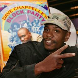 In this June 13, 2006, file photo, comedian Dave Chappelle promotes the release of his new DVD Dave Chappelle's Block Party, at the Virgin Megastore in Los Angeles.