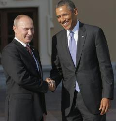Russian President Vladimir Putin shakes hands with  President Obama.