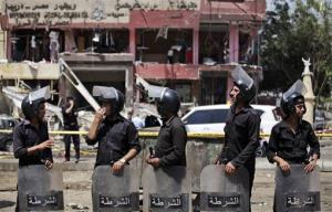 Egyptian security officers guard the scene of a bomb attack targeting the convoy of Egypt's Interior Minister Mohammed Ibrahim.