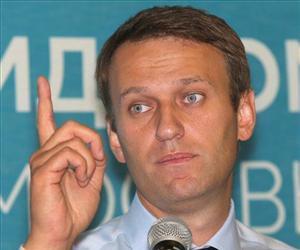 Russian opposition leader Alexei Navalny speaks at a news conference in Moscow, Russia, Sept. 5, 2013.