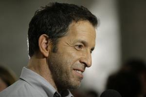 Designer Kenneth Cole considers a reporters question during Fashion Week in New York, Thursday, Feb. 7, 2013.