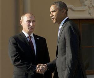 President Barack Obama shakes hands with Russian President Vladimir Putin during arrivals for the G-20 summit at the Konstantin Palace in St. Petersburg, Russia, Thursday, Sept. 5, 2013.