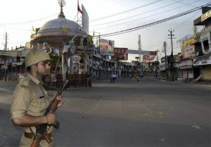 An Indian policeman stands guard during a curfew hours following riots and clashes between two communities in the Indian state of Uttar Pradesh.