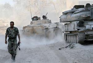 A Syrian army soldier walks on a street in the Jobar neighborhood of Damascus, Syria.