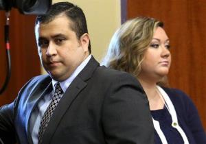 In this June 24, 2013 file photo, George Zimmerman, left, arrives in Seminole circuit court, with his wife Shellie, in Sanford, Fla.
