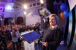 Erna Solberg, leader of the Conservative party, smiles and accepts the cheers from her supporters at the post election vigil for the Conservative party.