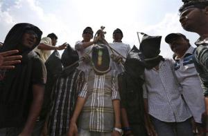 Indian protesters stage a mock hanging to demand death sentence for four men after a judge convicted them in the fatal gang rape of a young woman on a moving New Delhi bus, Tuesday, Sept. 10, 2013.
