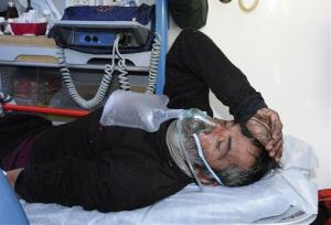 After being found in a remote mountain cabin, Uruguayan Raul Gomez uses a resuscitator in an ambulance that will transport him to a nearby hospital, in San Juan, Argentina, Sunday, Sept. 8, 2013.