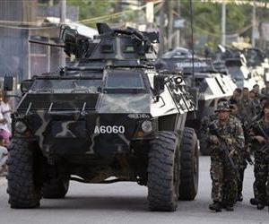 Government troops take their positions as about 200 Muslim rebels, enraged by a broken peace deal with the Philippine government, held scores of hostages as human shields Tuesday Sept. 10, 2013.