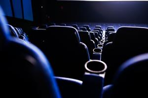 An irate movie blogger just called the cops after fellow moviegoers wouldn't cut it out with the cell phones.