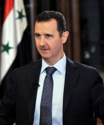 In this Sept. 8 photo released by the Syrian official news agency SANA, Syrian President Bashar Assad listens during an interview with PBS host Charlie Rose.