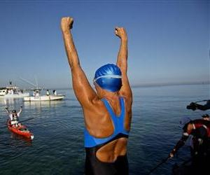 Diana Nyad, 64, greets her support team before her swim to Florida from Havana, Cuba, Saturday, Aug. 31, 2013.