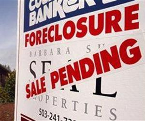 In this March 8, 2011, file photo, a foreclosed house with sale pending sign is shown in Tigard, Ore.