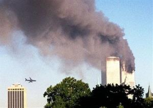 In this Sept. 11, 2001 file photo, American Airlines Flight 175 closes in on World Trade Center Tower 2 in New York, just before impact.