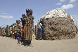 Turkana people wait in a line to receive food during a famine in central Turkana district, Kenya, where underground aquifers have been found.