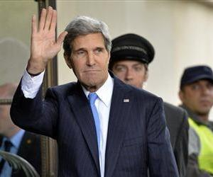 US Secretary of State John Kerry waves as he arrives in Geneva, Switzerland today, to test the seriousness of a Russian proposal to secure Syria's chemical weapons.
