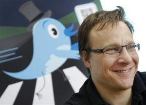 File photo of a Twitter spokesman, and the company logo.