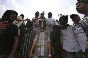 In this Tuesday, Sept. 10, 2013 file photo, Indian protesters stage a mock hanging scene demanding death sentences for four men after a judge convicted them in the fatal gang rape.