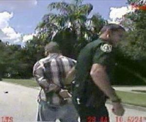 In this still image made from dash-cam video provided by the Lake Mary (Fla.) Police, George Zimmerman is detained by officers, Sept. 9, 2013.