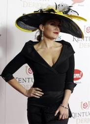 Miss American 2013 Mallory Hagan arrives to attend the 139th Kentucky Derby at Churchill Downs Saturday, May 4, 2013, in Louisville, Ky.
