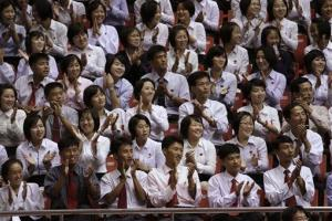 North Korean fans cheer as weightlifters compete during the 2013 Asian Cup and Interclub Weightlifting Championships in Pyongyang.
