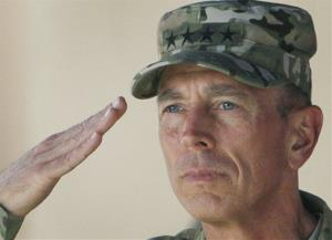 In this July 18, 2011 file photo, Gen. David Petraeus, then top commander of US and NATO forces in Afghanistan, salutes during a changing of command ceremony.