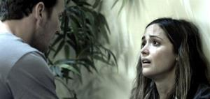 In this film publicity image released by Film District, Patrick Wilson, left, and Rose Byrne are shown in a scene from Insidious.
