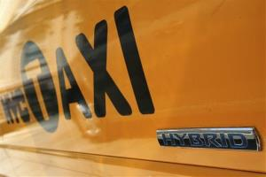A detail of a hybrid taxi cab is photographed outside New York's City Hall.