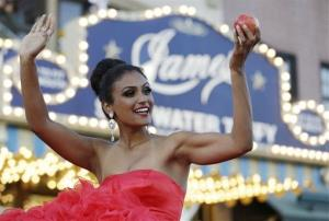 Miss New York Nina Davuluri smiles for the crowd during the Miss America Shoe Parade at the Atlantic City boardwalk, Saturday, Sept. 14, 2013, in Atlantic City, NJ.