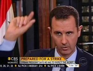 In this frame grab from video taken Sunday, Sept. 8, 2013, and provided by CBS This Morning, Syrian President Bashar Assad responds to a question from journalist Charlie Rose during an interview in Damascus, Syria. In the interview broadcast Monday on CBS, Assad threatened to retaliate for any military strike...
