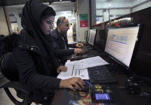Iranians surf the web in an Internet cafe at a shopping center in central Tehran, Iran.