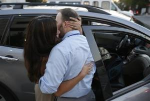 Edith Hutchins kisses her husband Shawn Hutchins as she picks him up at Nationals Park after he was evacuated from the Washington Navy Yard, Monday Sept. 16, 2013.
