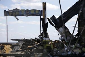 The sign for Funtown Pier stands above charred rubble in Seaside Park, N.J., Tuesday.