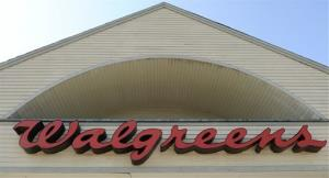 FILE - The sign above a Walgreens entrance, is seen in this Monday, Sept. 28, 2009 file photo taken in Gloucester, Mass. Walgreen Co. will become the latest big employer to send its workers shopping for their health insurance coverage instead of providing a few plan choices for them. The...