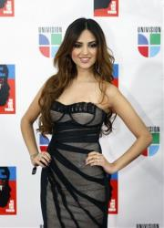 Eiza Gonzalez poses on the red carpet as she goes in to record the Spanish language version of We Are The World (Somos el Mundo) with other top Latin music artists Friday, Feb. 19, 2010 in Miami.