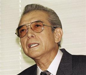 In this Friday, June 12, 1992 file photo, Hiroshi Yamauchi, then-president of Nintendo, answers questions after he won approval to buy the Seattle Mariners.