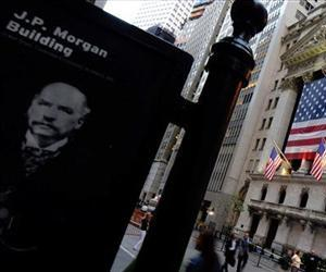 This Monday, Sept. 29, 2008, file photo, shows a picture of financier J.P. Morgan across the street from the New York Stock Exchange.