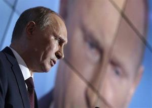 Russian President Vladimir Putin gestures during the final plenary meeting of the Valdai International Discussion Club in the Novgorod Region, on the banks of Lake Valdai, Russia, Sept. 19, 2013.