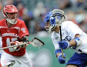 Duke's David Lawson, right, brings the ball past Cornell's Jason Noble (45) during the second half of an NCAA college Division 1 semifinal lacrosse game on Saturday, May 25, 2013, in Philadelphia.