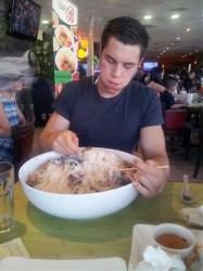 Eric Dahl, a University of Wisconsin computer engineering student with a nickname of Silo, fills up on a 13-pound bowl of Vietnamese noodles known as pho.